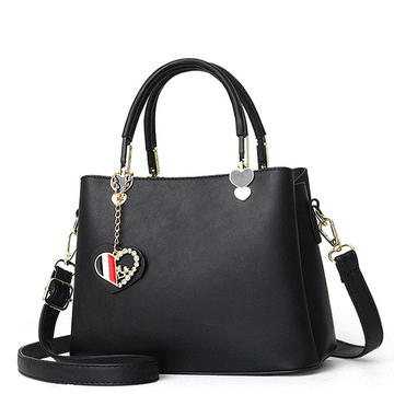 甜美氣質純色愛心吊飾手提包
